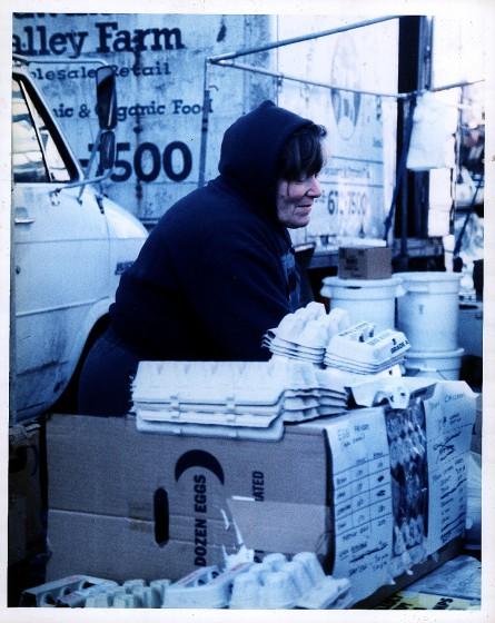 Woman w_ egg cartons